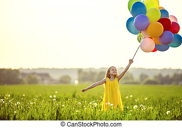 Carefree - Little girl with balloons in the field