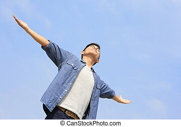 Carefree man - Carefree and free man raised hands and...