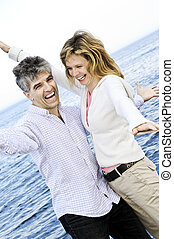 Carefree mature couple - Carefree mature baby boomer couple...