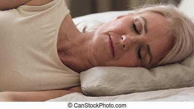 Carefree mature older granny seeing sweet dreams. - Head ...