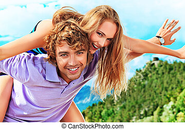 carefree - Portrait of a happy couple enjoying vacation on...