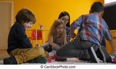 Carefree preschool children relaxing in playroom