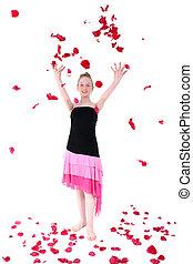 Carefree Teen Throwing Rose Petal Into The Air - Teen girl...