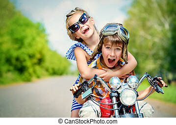 carefree trip - Happy kids go on a journey on a motorcycle...