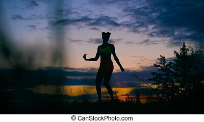 carefree woman dancing in the sunset. vacation vitality healthy living concept.