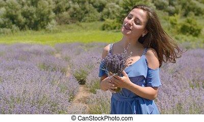 Carefree woman enjoying life in lavender field - Carefree...