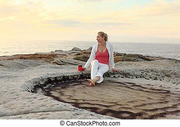 Carefree woman enjoys morning coffee