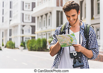Carefree young man searching for place of destination