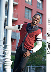 Carefree young man smiling outdoors