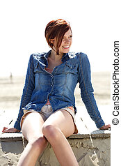 Carefree young woman smiling outdoors