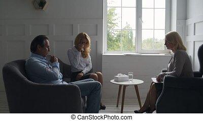 Careful husband calming his wife down