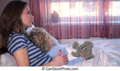 Careful mom woman fondle caress little daughter girl sitting...