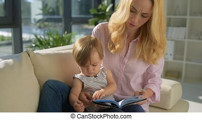 Careful mother reading stories to the child