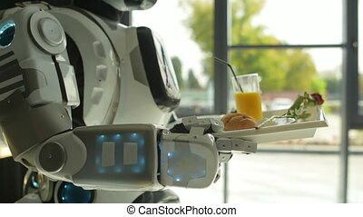 Careful robot carrying tray with breakfast - Machine also...