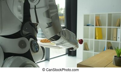 Careful robotic machine brining breakfast for woman