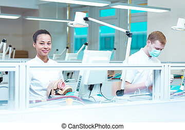 Careful students in modern dental office