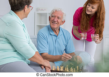 Caregiver and elderly couple