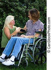 Caregiver Comforter - Caregiver tries to comfort an elderly...
