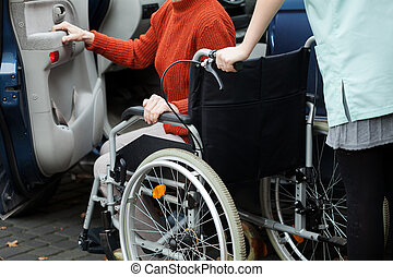 Caregiver helping get into the car
