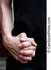 Caregiver holding senior lady's hand