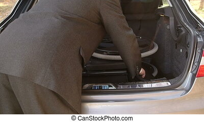 wheelchiar in car trunk - Caregiver man loading and...