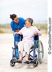 caregiver talking to senior woman