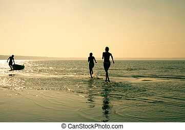 careless summer - silhouette image of two running girls and...