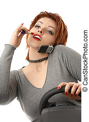 Scene - the woman doing a make-up during driving on the car, isolated