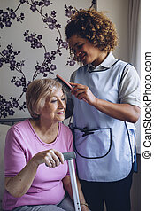 Carer Brushing Patients Hair - Home Caregiver brushing the...