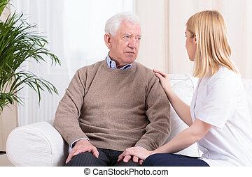 Carer supporting senior man