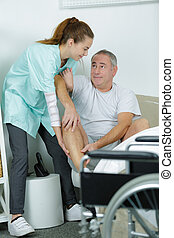 carer with man in wheelchair