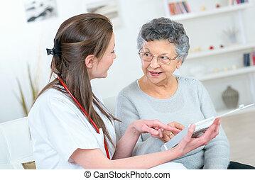 Carer with senior citizen