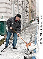 Snow clearance by a caretaker