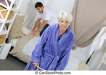 caretaker helping senior woman at home
