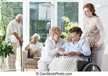 Caretaker pushing wheelchair
