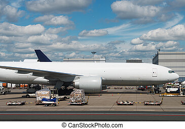 Cargo aircraft is loading at the airport.