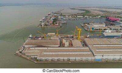 cargo and passenger seaport in surabaya, java, indonesia -...