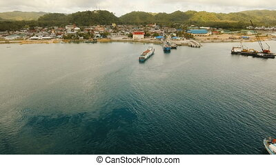 Cargo and passenger transit port in Dapa city aerial view .Siargao island, Philippines.