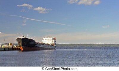 Cargo barge moored at pier, Onega, Petrozavodsk