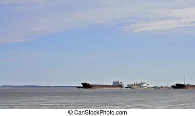 Cargo barges, vessels, boats moored on lake Onega - Cargo...