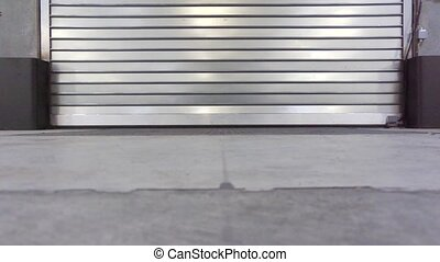 Cargo bay opening - Roller shutters of a cargo bay opening,...