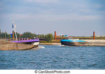 cargo boats on river