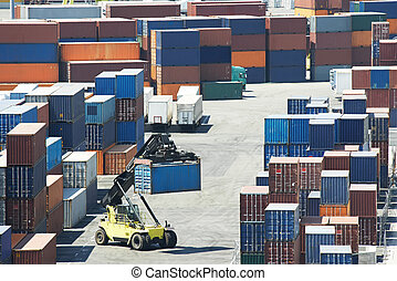 Cargo container boxes in dock terminal - Heavy forklift...
