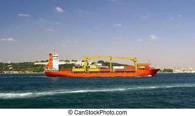 Cargo container ship sails into