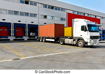 Cargo container - Unloading big container trucks at...