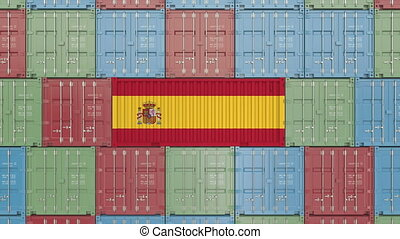 Cargo container with flag of Spain. Spanish import or export...