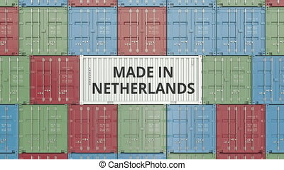 Cargo container with MADE IN NETHERLANDS text. Dutch import...