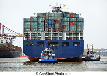 Cargo containers in the port of Hamburg - Container ships in...