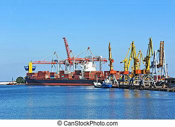 Container stack and ship under crane bridge