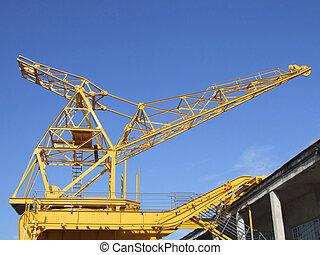 Big metal yellow crane in the port
